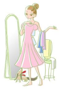 服が似合うか鏡で確認する女性